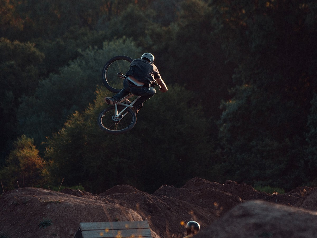 An image of a man on a bike getting some air off a jump.