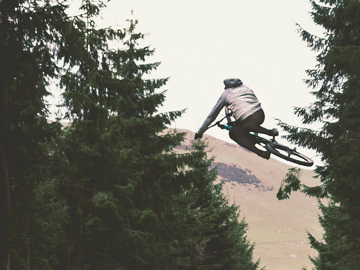 An image of a man getting some air off a jump on a bike.