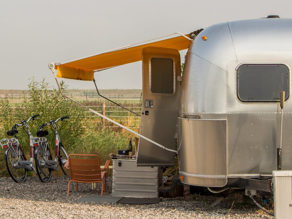 An image of a motor home in the middle of nowhere.